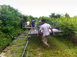 Moving the bamboo train trolleys on the track, Battambang, Cambodia