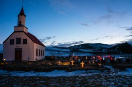Church and graveyard with Christmas lights in Iceland