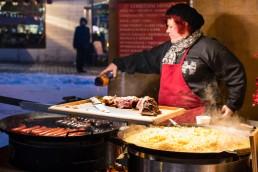 Preparing food at the Christmas market of Tallinn Old town, Estonia