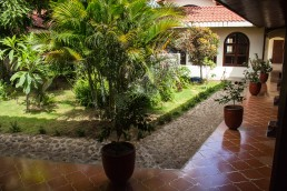 inner yard garden of Hotel Flor de Sarta in León, Nicaragua