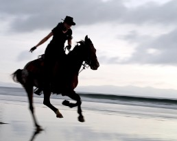 Piritta riding at the beach at Rancho Chilamate, Nicaragua