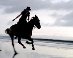 Piritta riding at the beach at Rancho Chilamate, Nicaragua