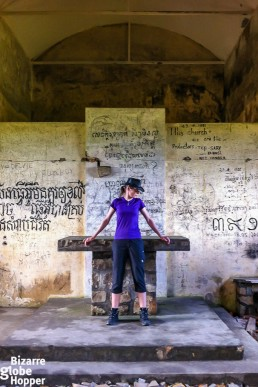 Me at the altar in the old church in Bokor Hill Station, Cambodia