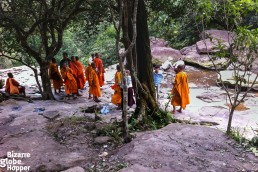 Monks at the waterfall in Bokor Hill Station, Cambodia