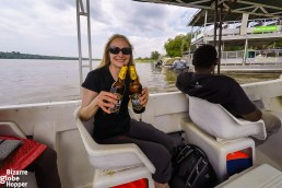Niina and local beer on the Nile river in Murchison Falls National Park, Uganda
