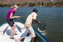 Niina catching her tigerfish in Lower Zambezi National Park, Zambia