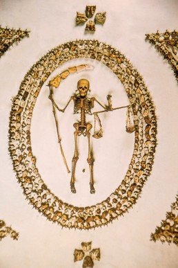 Skeleton in the ceiling of the Capuchin Crypt in Rome, Italy.