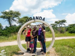 Us with a Ugandan family at the Equator, Uganda