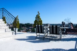 The upper suite of Hotel Lord Byron has a huge terrace with views over Borghese gardens