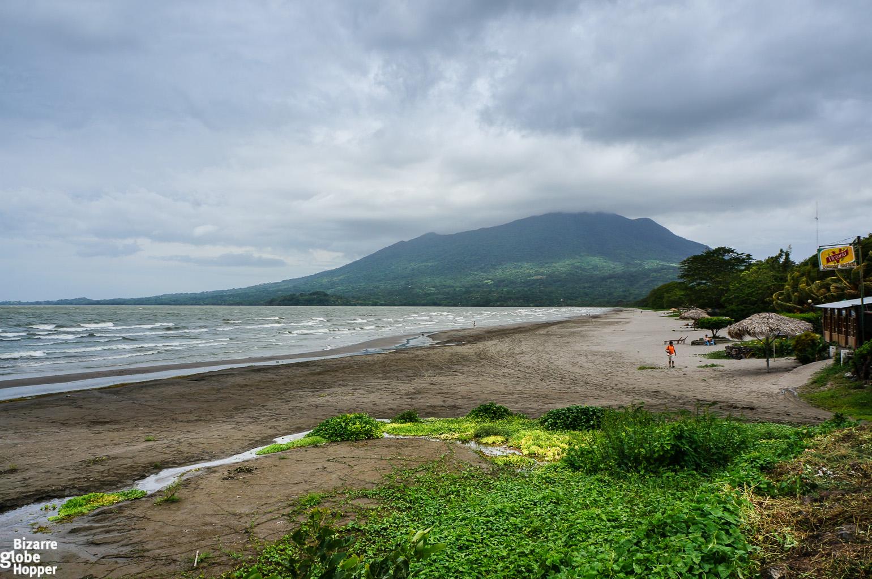 Imposing Volcanos Against Black Sand Beaches In Ometepe Island Nicaragua