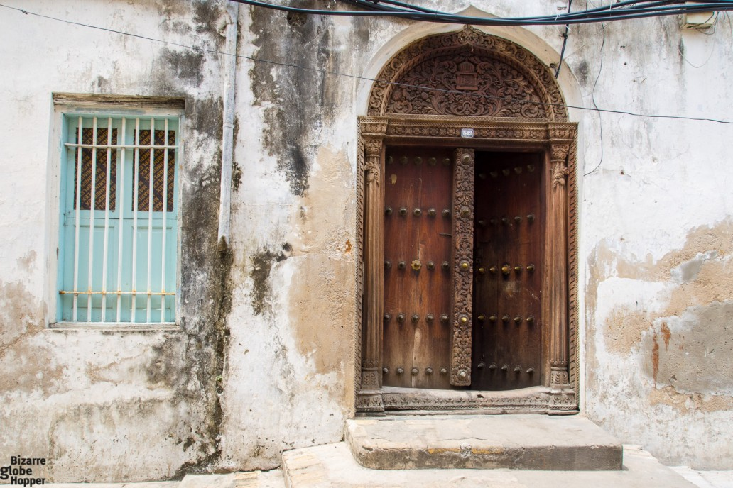 Carved Indian Door with brass studs Stone Town Zanzibar & The Doors of Stone Town Zanzibar \u2013 Bizarre Globe Hopper