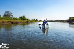 Canoeing through shallow channel on the Zambezi