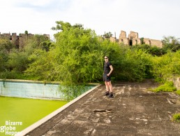 Piritta posing at the ruins of swimming pool. From here you can see all the way to Zaire!