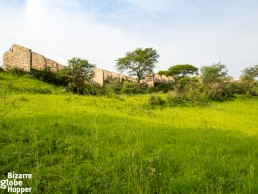 Idi Amin's Pakuba Safari Lodge ruins seen from the shore