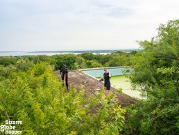 Piritta exploring the ruins of Idi Amin's swimming pool