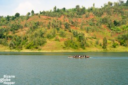 Locals travelinf through Lake Kivu with a small passenger boat