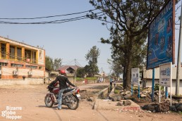 A moto-taxi driver waits for clients on the outskirts of Goma, Democratic Republic of the Congo.