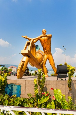 A communist-styled statue stands in a roundabout in the middle of the center of Goma, Democratic Republic of the Congo.