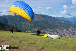 Piritta is just taking off with her paragliding instructor from the hills of Medellín