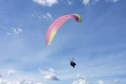 Hello from the air! That's me paragliding over the skies of Medellín