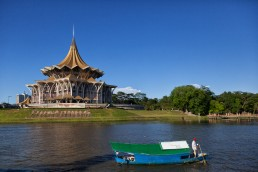 Kuching Waterfront lines the south bank of Sarawak river, offering scenic views towards Fort Margherita and the Astana
