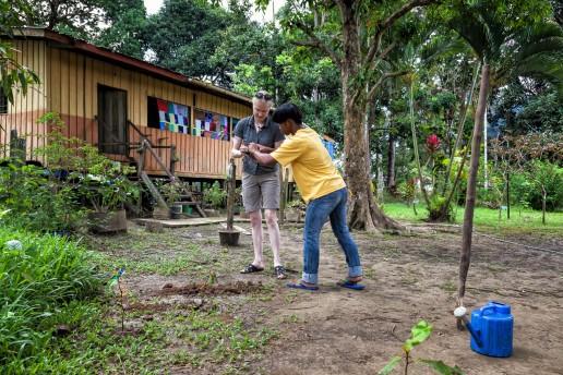 Planting a tree at the Kinabatangan River in Borneo.