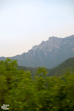 Craggy peaks behind vegetation between Sarajevo and Mostar