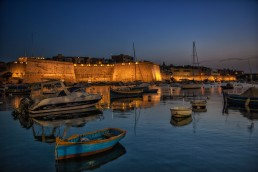 The harbor of Kalkara Bay at night in Malta.