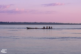 Take a sunset tour in the Colombian Amazonas to meet local families and fishermen
