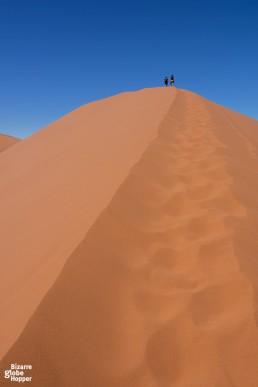 Climbing dunes in Namib desert, Namibia
